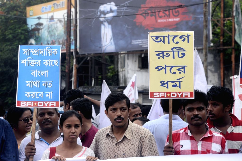 SFI and DYFI activists stage a demonstration against the recent communal violence at Baduria; in Kolkata on July 7, 2017.