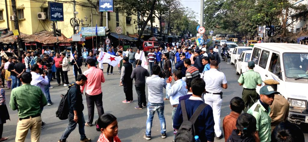 SFI and DYFI activists stage a demonstration against West Bengal Government in Kolkata on Jan 29, 2019.