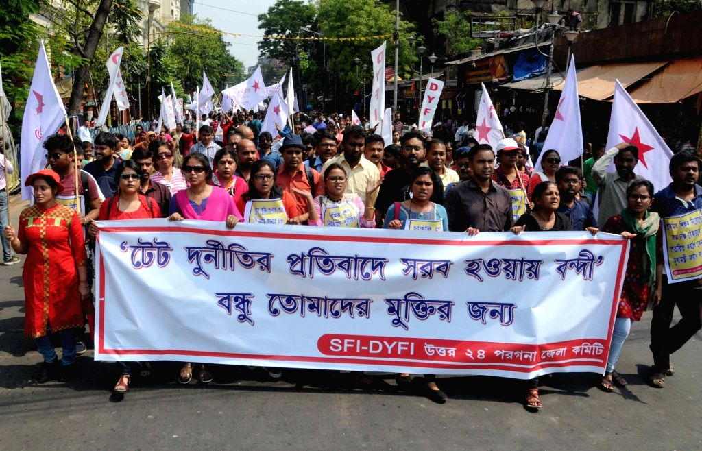 SFI, DYFI activists participate in a protest rally against the police's lathi charge and arrest of leaders in a peaceful rally at Esplanade; in Kolkata on March 14, 2017.
