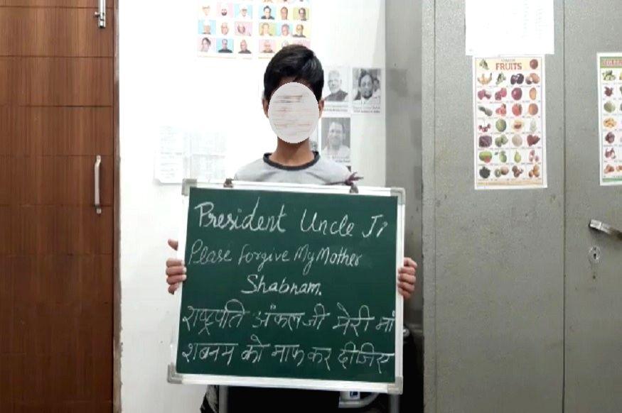 Shabnam's son with placard.