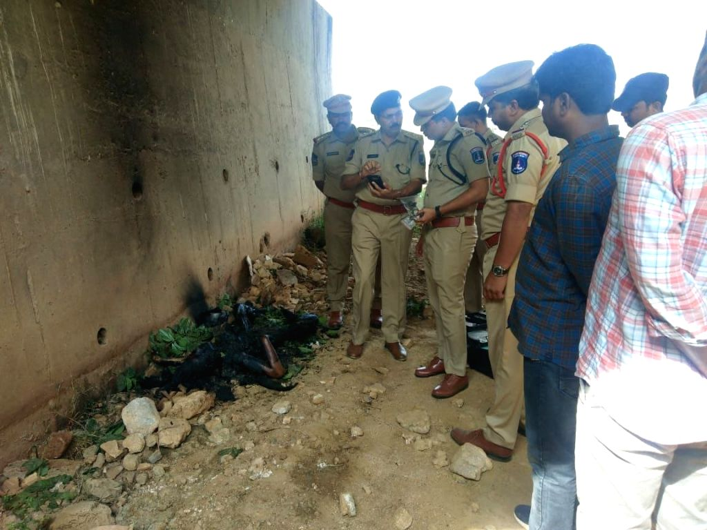 Shadnagar: Police personnel investigate after they found the charred body of a 26-year-old veterinary doctor Priyanka Reddy beneath a culvert on the Hyderabad-Bengaluru national highway at Shadnagar on the city outskirts in Ranga Reddy district of Te - Priyanka Reddy and Ranga Reddy