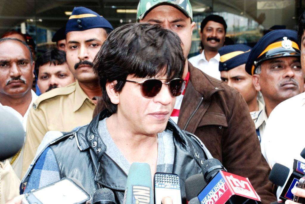 Shah Rukh Khan arrive back in Mumbai.