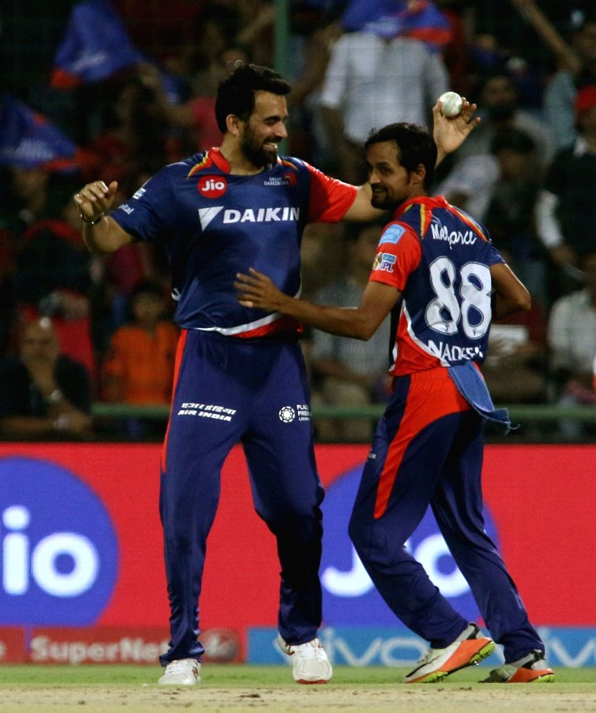 Shahbaz Nadeem of Delhi Daredevils celebrates fall of Chris Gayle's wicket during an IPL 2017 match between Delhi Daredevils and Royal Challengers Bangalore at Feroz Shah Kotla Ground in ...