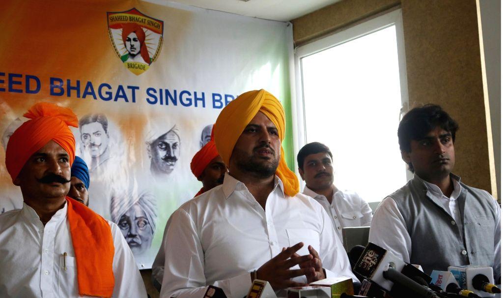 "Shaheed Bhagat Singh's grandnephew Yadavendra Singh addresses a press conference regarding ""Shaheed Samman Jagrity Yatra"" in New Delhi on Sept 24, 2016. - Bhagat Singh and Yadavendra Singh"