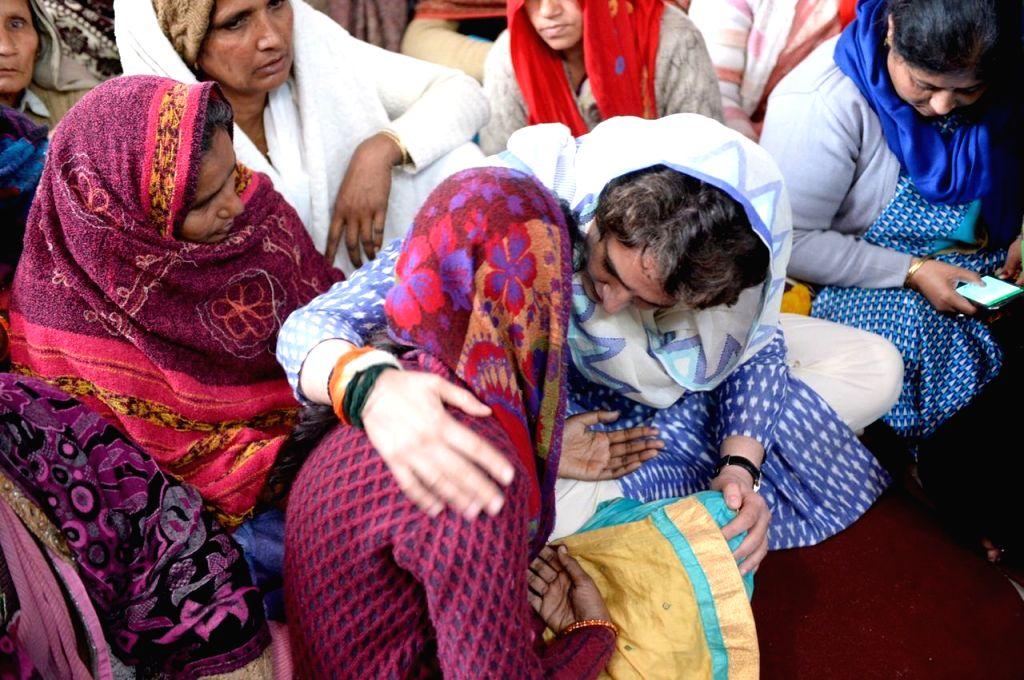 Shamli: Congress General Secretary (Uttar Pradesh East) Priyanka Gandhi visits the grief struck family members of martyr Amit Kumar Kori, one of the 40 CRPF personnel killed in 14 Feb Pulwama ... - Priyanka Gandhi and Amit Kumar Kori