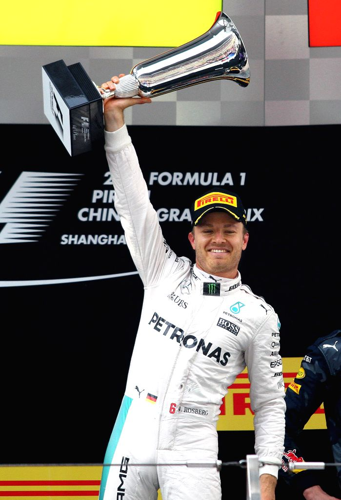 SHANGHAI, April 17, 2016 - Mercedes AMG Petronas F1 Team's German driver Nico Rosberg celebrates with his trophy after winning the Formula One Chinese Grand Prix in Shanghai on April 17, 2016.