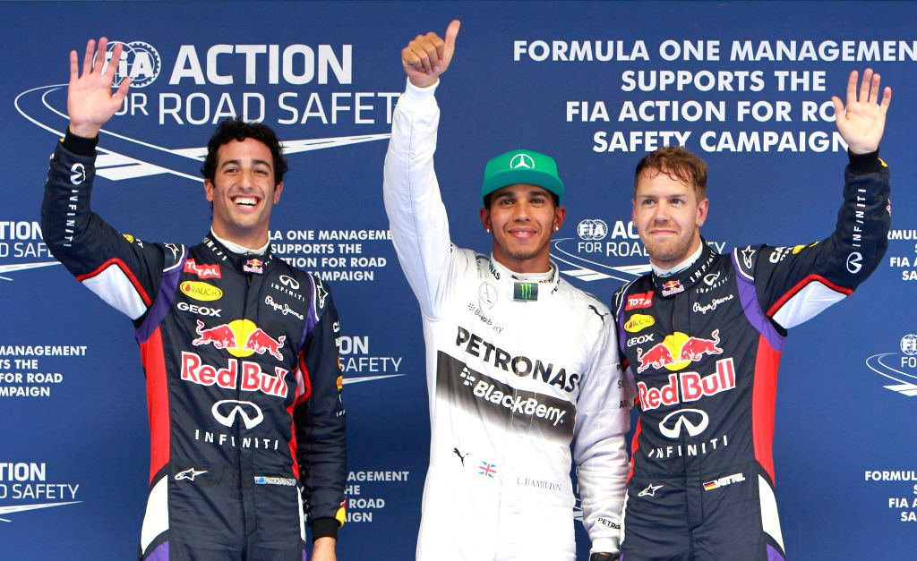 Mercedes AMG Petronas British driver Lewis Hamilton (C), Red Bull Australian driver Daniel Ricciardo (L) and his teammate Spanish driver Sebastian Vettel greet ...
