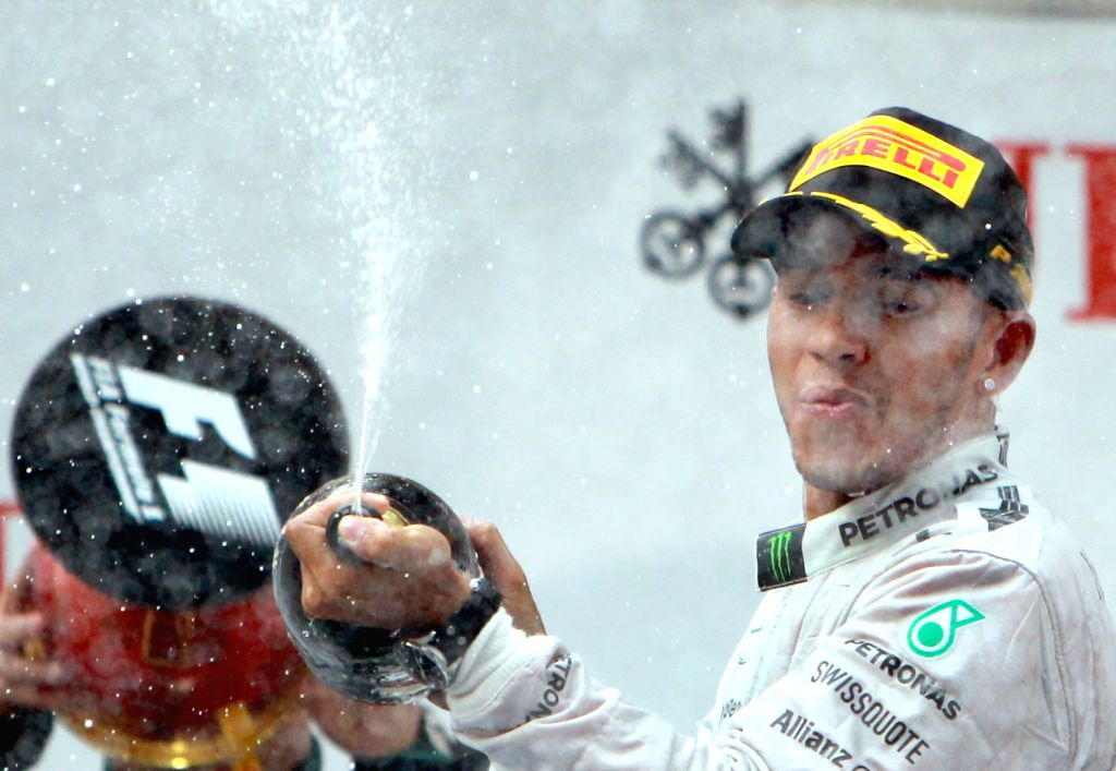 Mercedes AMG Petronas British driver Lewis Hamilton celebrates with champagne on the podium after winning the the Formula One Chinese Grand Prix in Shanghai, east