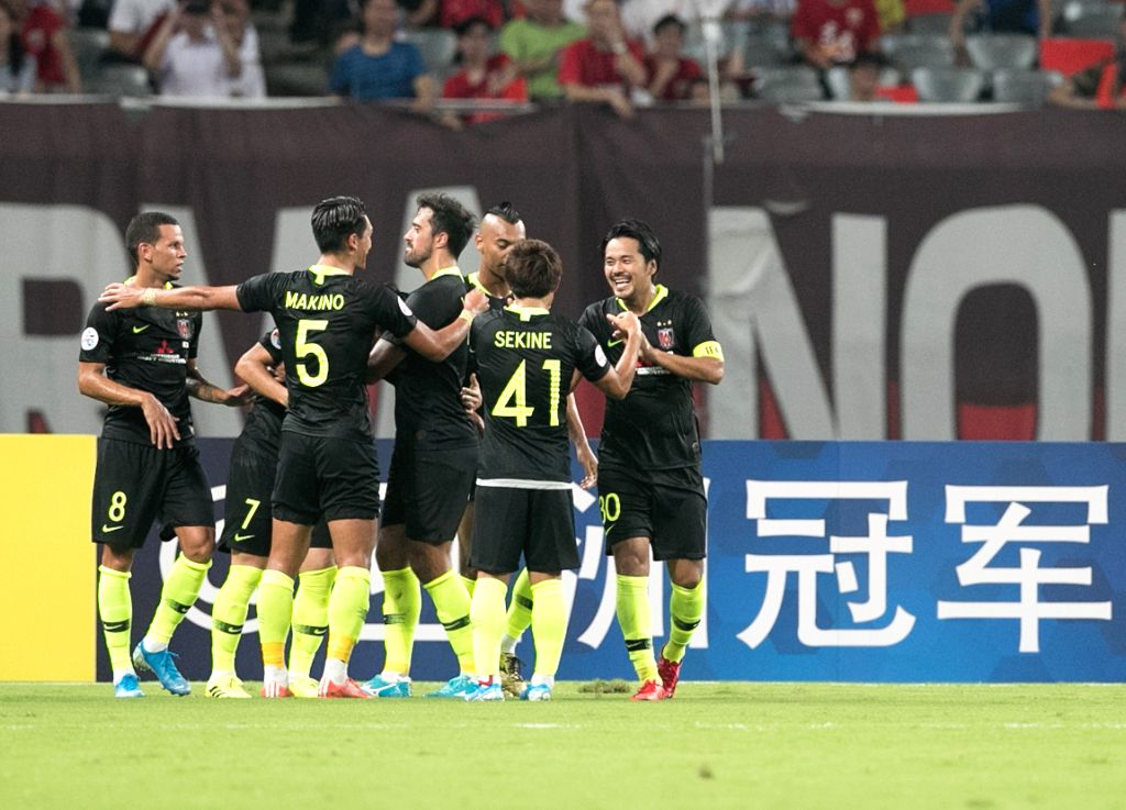 SHANGHAI, Aug. 28, 2019 - Players of Urawa Red Diamonds celebrate scoring during an AFC Champions League match between Shanghai SIPG FC of China and Urawa Red Diamonds of Japan in Shanghai, east ...