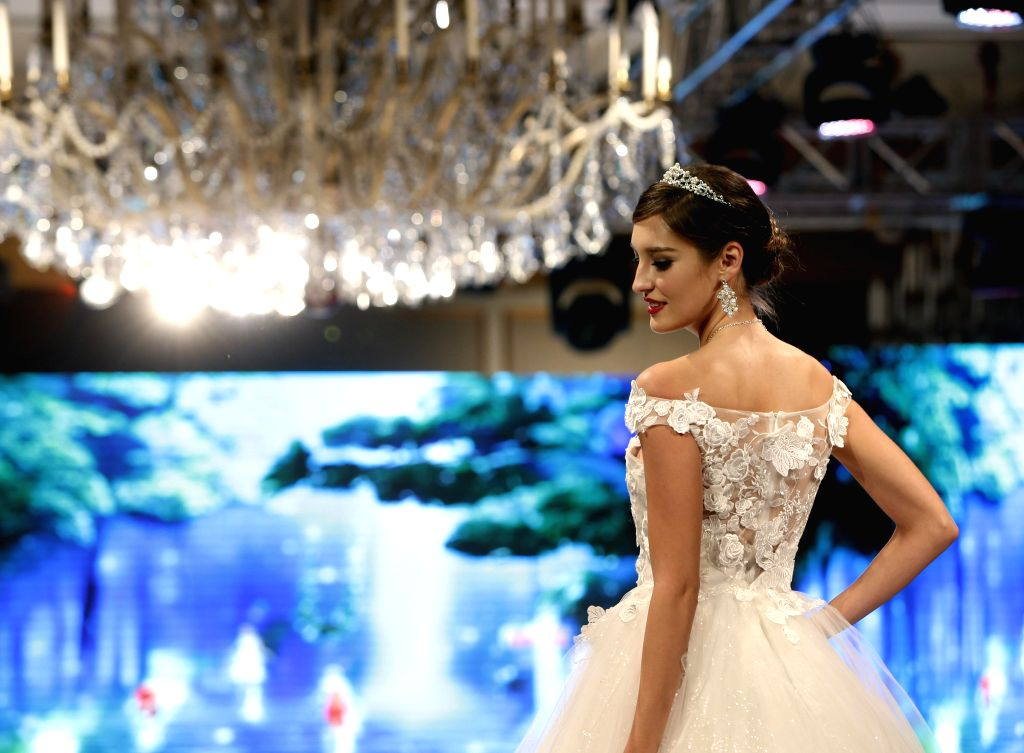 A model presents a wedding dress creation by Japanese designer Yumi Katsura during a show in Shanghai, east China, Feb. 14, 2015.