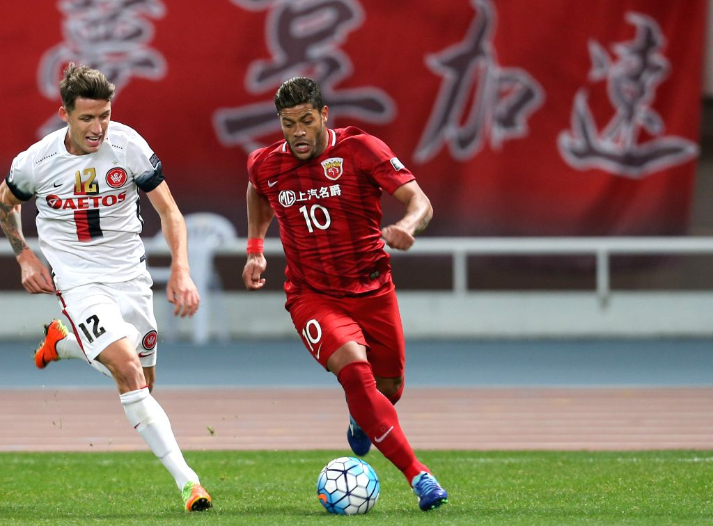 SHANGHAI, Feb. 28, 2017 - Hulk (R) of China's Shanghai SIPG FC vies with Scott Neville of Australia's Western Sydney Wanderers during their AFC Champions League Group F match at Shanghai Stadium in ...