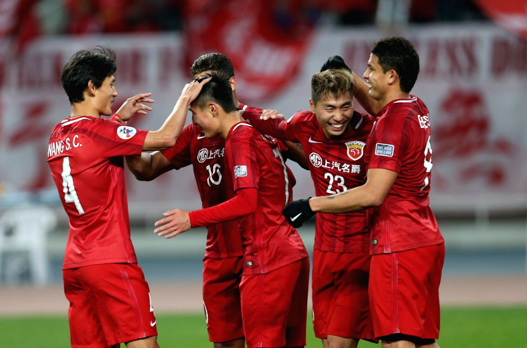 SHANGHAI, Feb. 28, 2017 - Players of China's Shanghai SIPG FC celebrate Wu Lei's goal during the AFC Champions League Group F match against Australia's Western Sydney Wanderers at Shanghai Stadium in ...