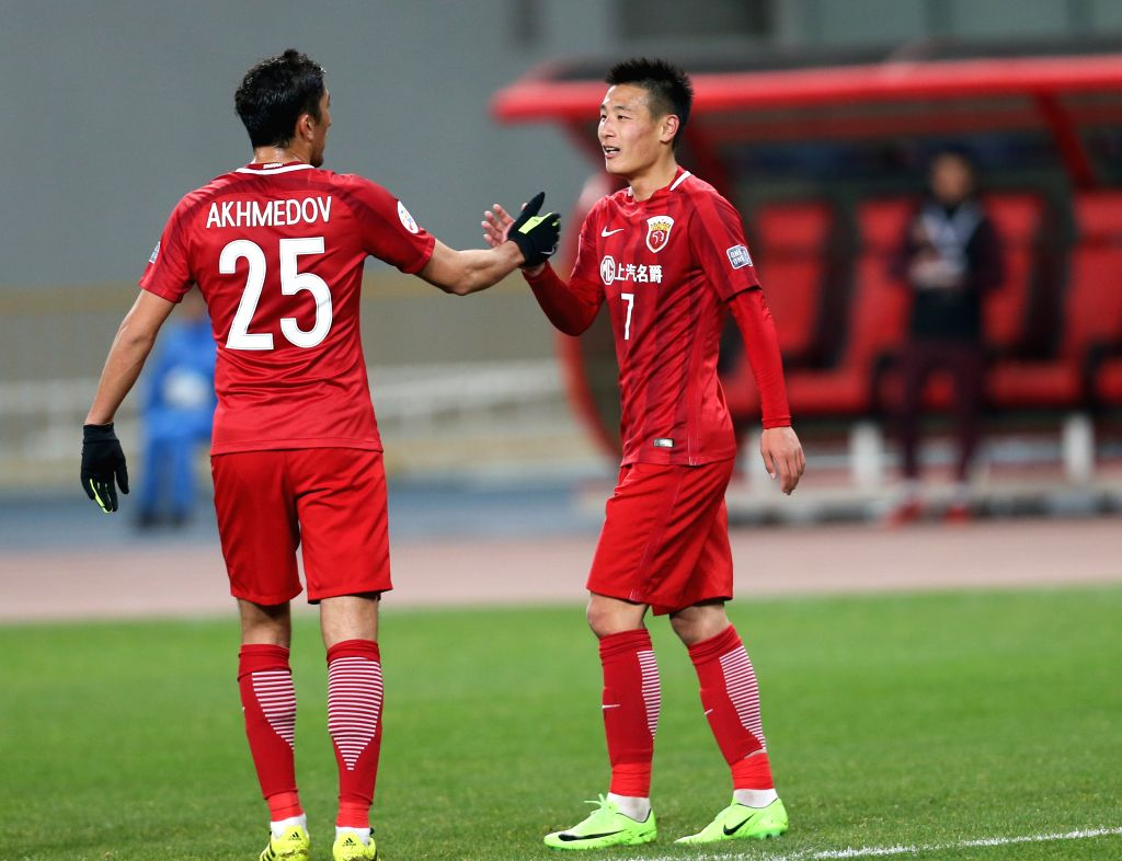 SHANGHAI, Feb. 28, 2017 - Wu Lei (R) of China's Shanghai SIPG FC celebrates scoring with teammate Odil Ahmedov during the AFC Champions League Group F match against Australia's Western Sydney ...