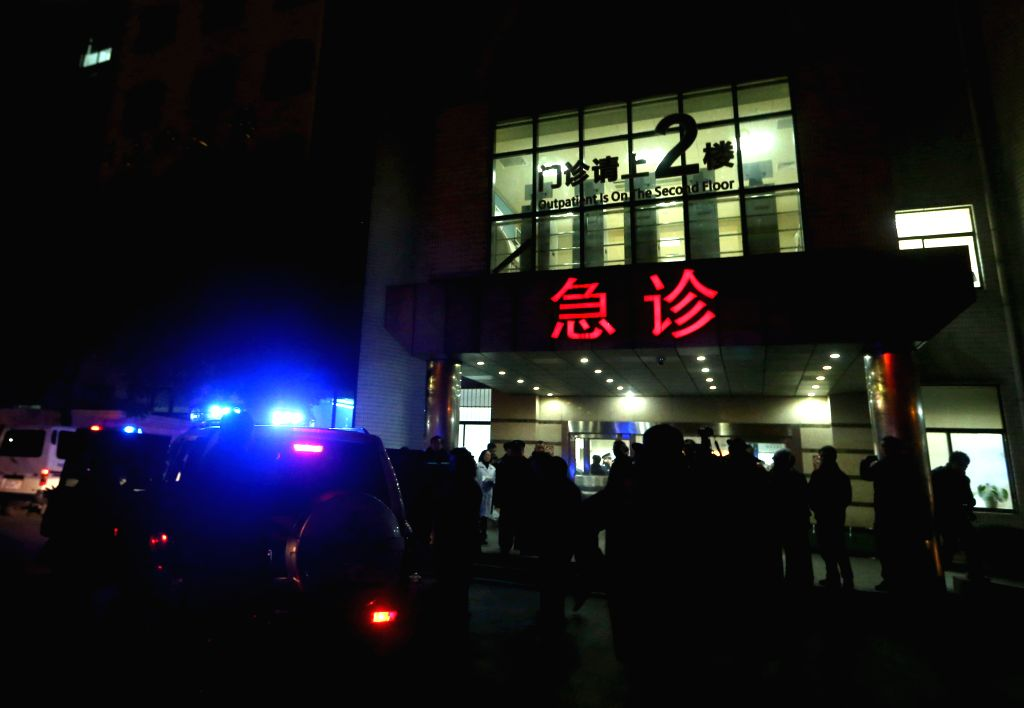 Medical workers are seen outside the emergency ward of the No. 1 People's Hospital of Shanghai after a stampede caused casualties among people who took part in new .