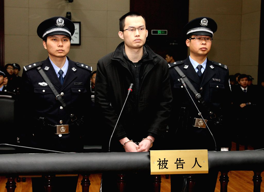 Lin Senhao (C) stands trial at the Shanghai Higher People's Court in Shanghai, east China, Jan. 8, 2015. The court on Thursday upheld the death sentence of Lin ...