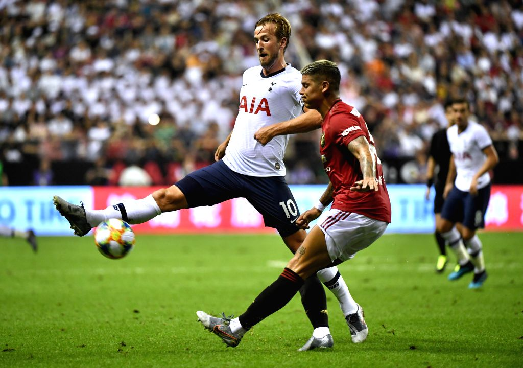 SHANGHAI, July 25, 2019 - Harry Kane (L) of Tottenham Hotspur fights for the ball against Marcos Rojo of Manchester United during the 2019 International Champions Cup football match between ...