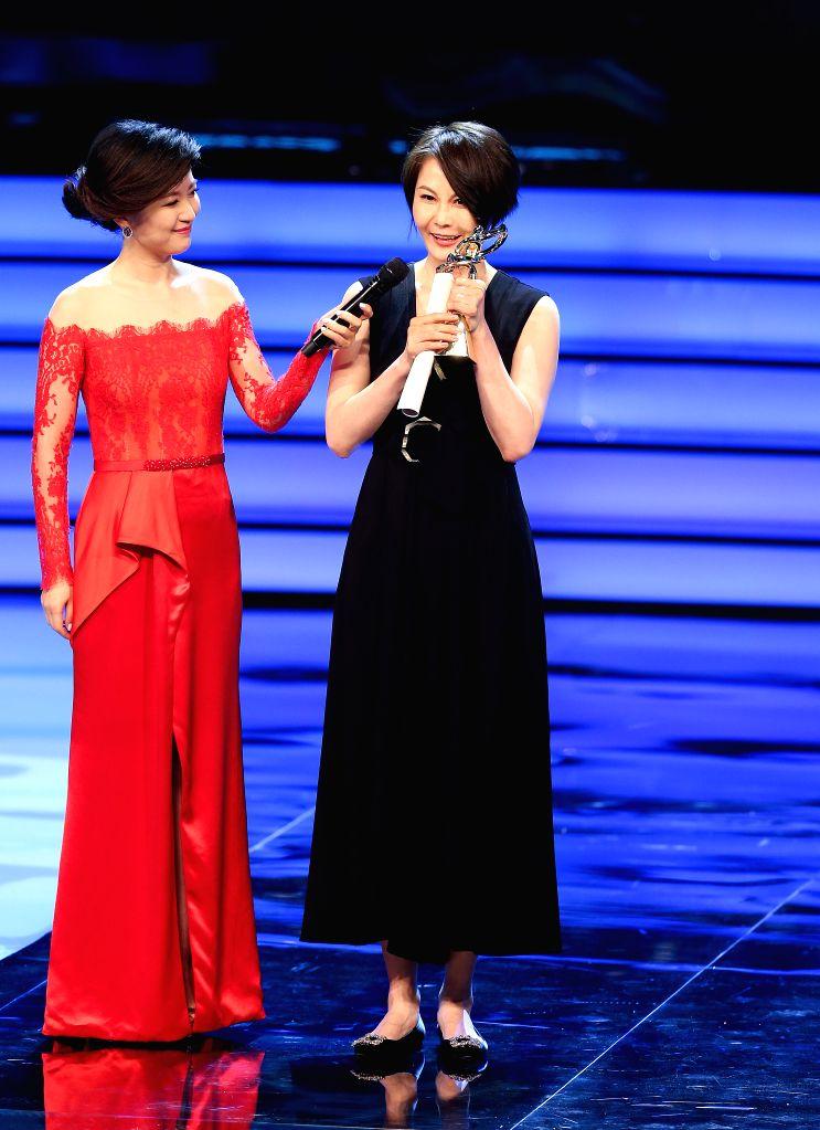 SHANGHAI, June 17, 2017 - Zhang Lei (R) wins Magnolia Award for best screenwriter of the 23rd Shanghai TV Festival, in Shanghai, east China, June 16, 2017.