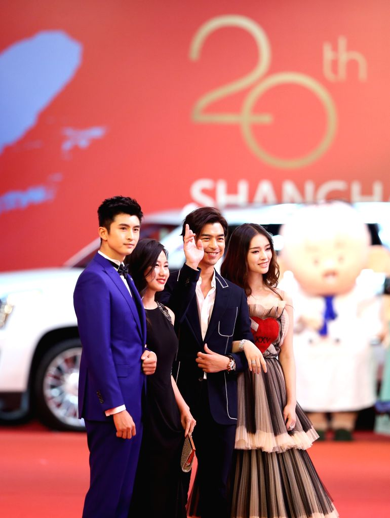 SHANGHAI, June 18, 2017 - Actor Chen Bo-Lin (2nd R) and actress Jelly Lin (1st R) attend the 20th Shanghai International film festival in Shanghai, east China, June 17, 2017. The 20th Shanghai ... - Chen B
