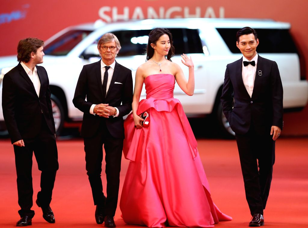 SHANGHAI, June 18, 2017 - Actress Liu Yifei (2nd R) and actor Kevin Yan (1st R) attend the 20th Shanghai International Film Festival in Shanghai, east China, June 17, 2017. The 20th Shanghai ... - Liu Yifei