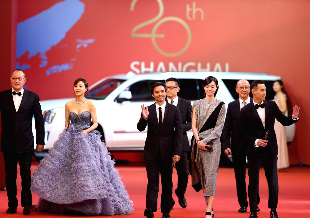 "SHANGHAI, June 18, 2017 - Director Stephen Fung (C) and cast members of flim ""The Adventurers "" attend the 20th Shanghai International film festival in Shanghai, east China, June 17, 2017. ..."
