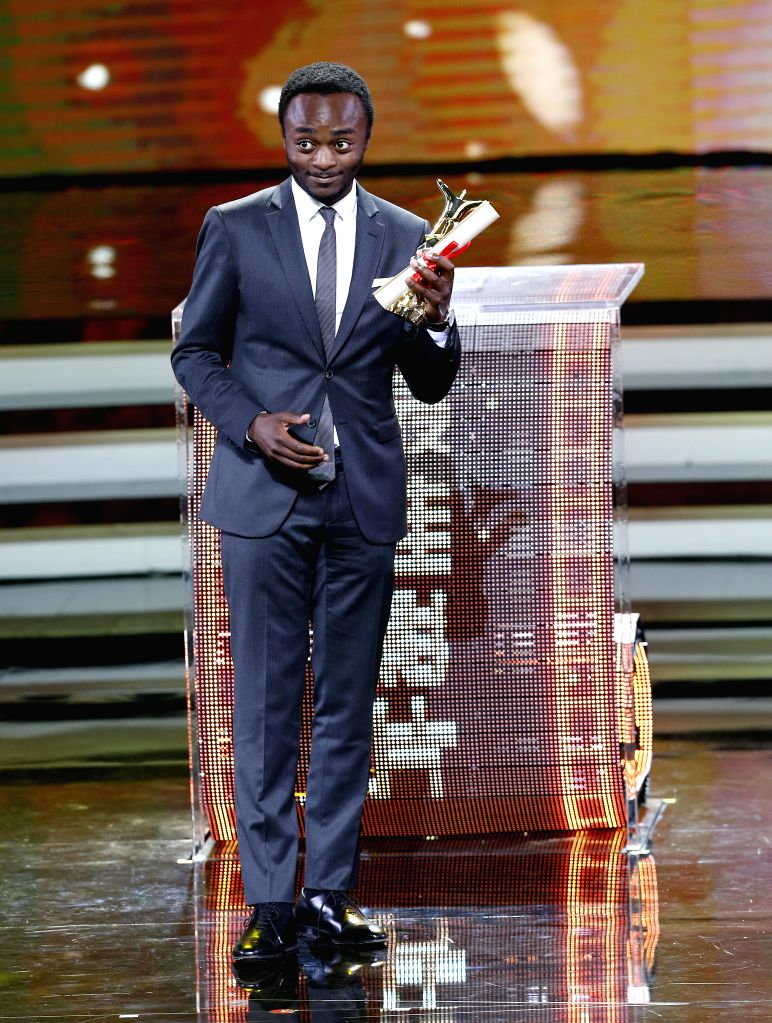 A actor of film Jamais De La Vie receives the prize of the Jinjue Award for Best Film during the awarding ceremony of the Shanghai International Film Festival, in ...