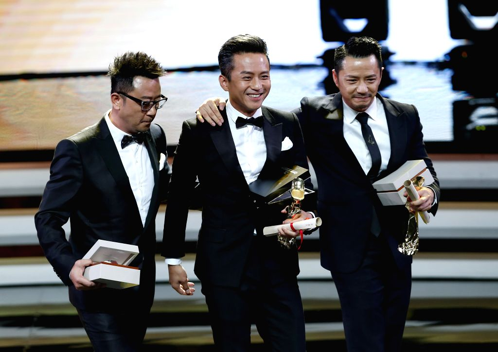 Actor Deng Chao(C), Duan Yihong (R) and Guo Tao win the Jinjue Award for Best Actor during the awarding ceremony of the Shanghai International Film Festival, in ... - Deng Chao
