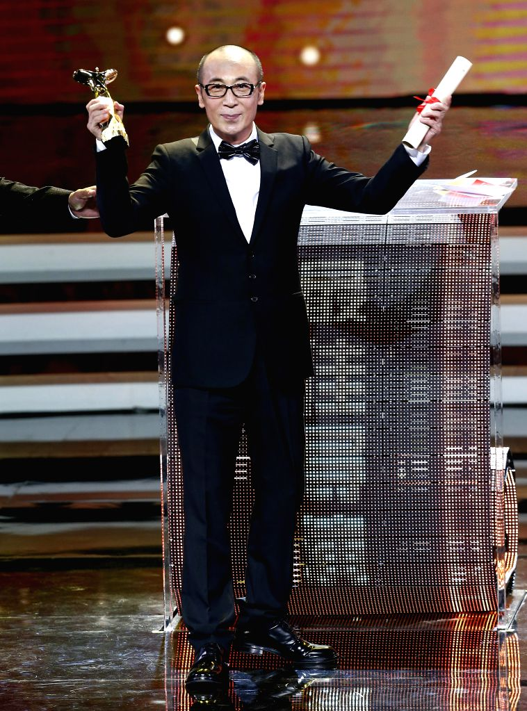 Cao Baoping, director of the film The Dead End, wins the Jinjue Award for Best Director during the awarding ceremony of the Shanghai International Film Festival, ...