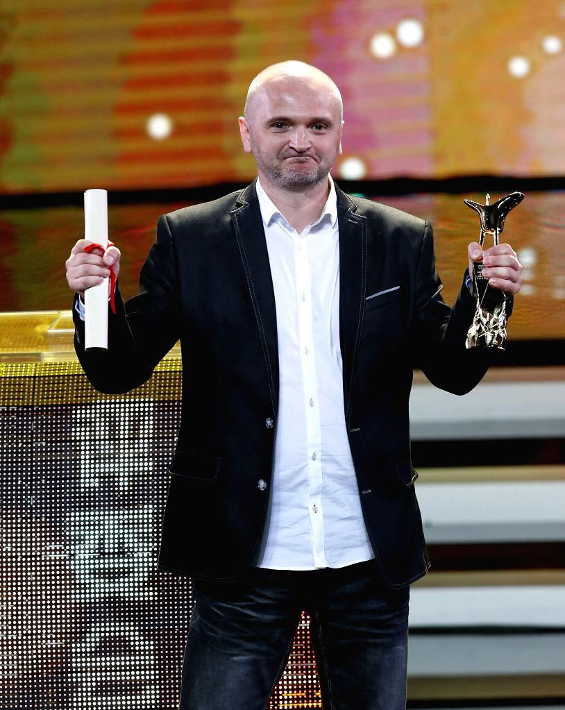 Jacek Lusinski, director of film Carte Blanche, receives the Jinjue Award for Jury Prize during the awarding ceremony of the Shanghai International Film Festival, ...