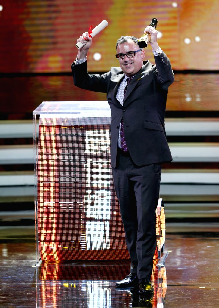 Patrick Tobin, screenplay of film Cake, receives the Jinjue Award for Best Screenplay during the awarding ceremony of the Shanghai International Film Festival, in ...