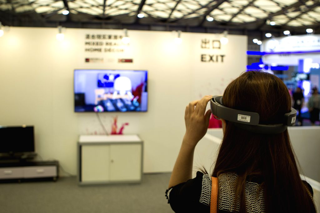 SHANGHAI, June 28, 2017 - People visit the Mobile World Congress 2017 in Shanghai, east China, June 28, 2017. The event featured its world-class industry exhibition bringing together the leading ...