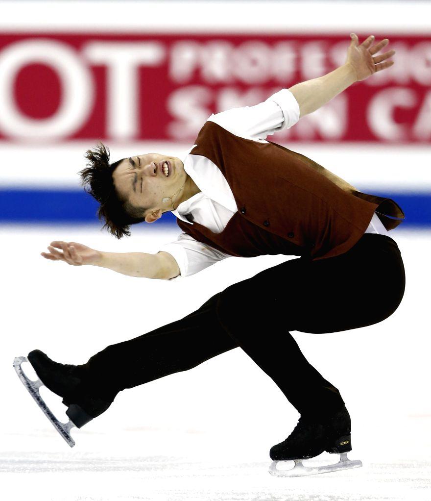 Yan Han of China competes during Men's Short Program segment in ISU World Figure Skating Championships 2015 at Crown Indoor Stadium, Oriental Sports Center in ...