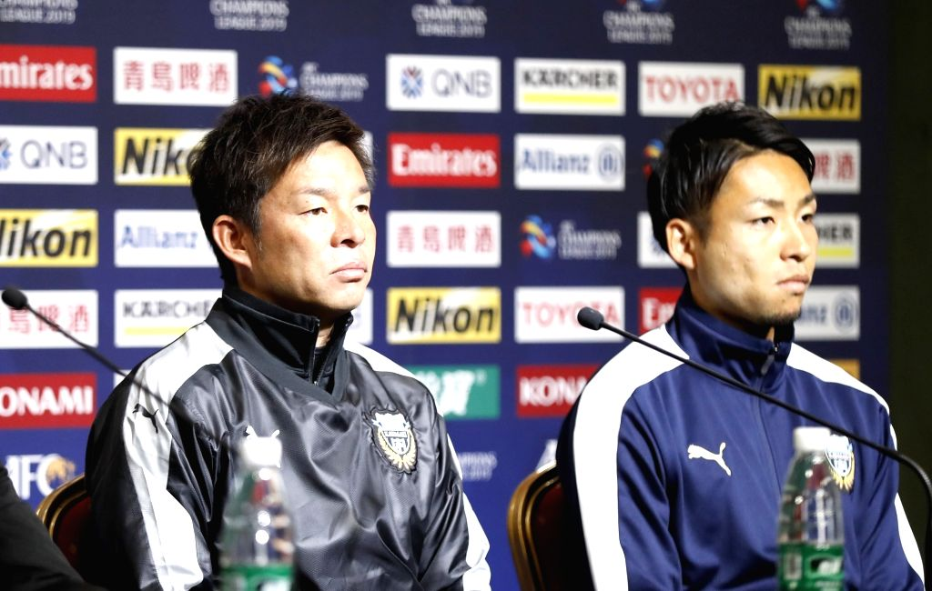 SHANGHAI, March 5, 2019 - Japan's Kawasaki Frontale's head coach Toru Oniki (L) and player Yu Kobayashi look on during the pre-match press conference one day ahead of the group H match between ...