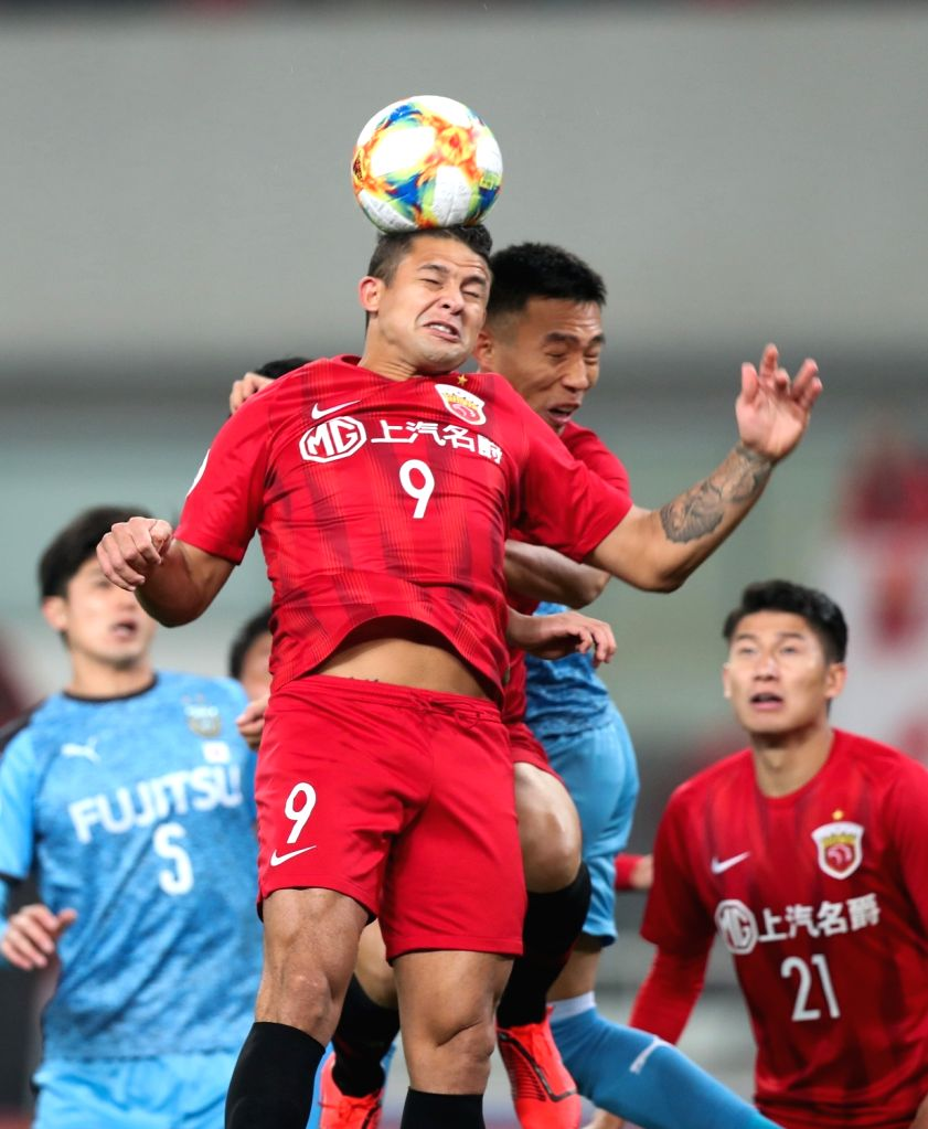 SHANGHAI, March 6, 2019 - Shanghai SIPG FC's Elkeson (top L) vies for a header during a Group H match between China's Shanghai SIPG FC and Japan's Kawasaki Frontale at 2019 AFC Champions league in ...
