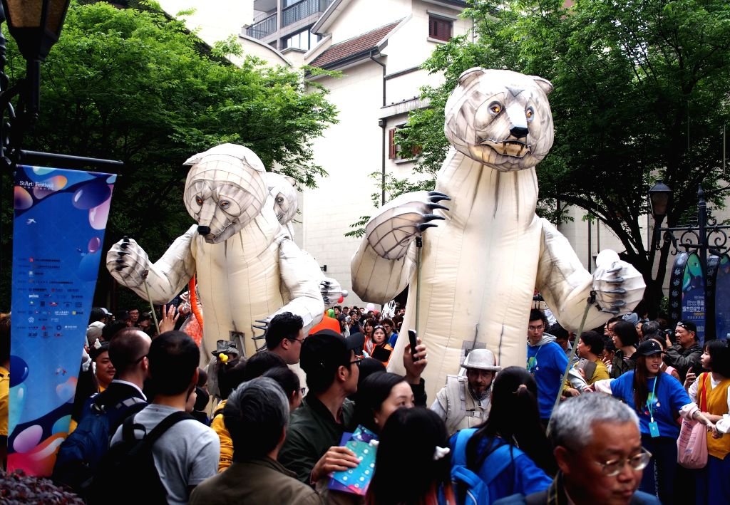 SHANGHAI, May 1, 2019 - Tourists join a puppet parade held at the Sinan Mansions in east China's Shanghai, May 1, 2019. Tourism boosts as many people go out for recreational activities during China's ...