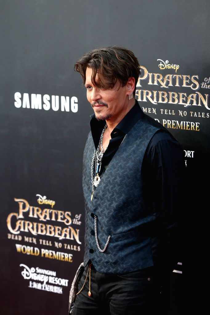 """SHANGHAI, May 11, 2017 - Actor Johnny Depp attends the global premiere of Hollywood film """"Pirates of the Caribbean: Dead Men Tell No Tales"""", in Shanghai, China, May 11, 2017. (Xinhua/Ding ... - Johnny Depp"""