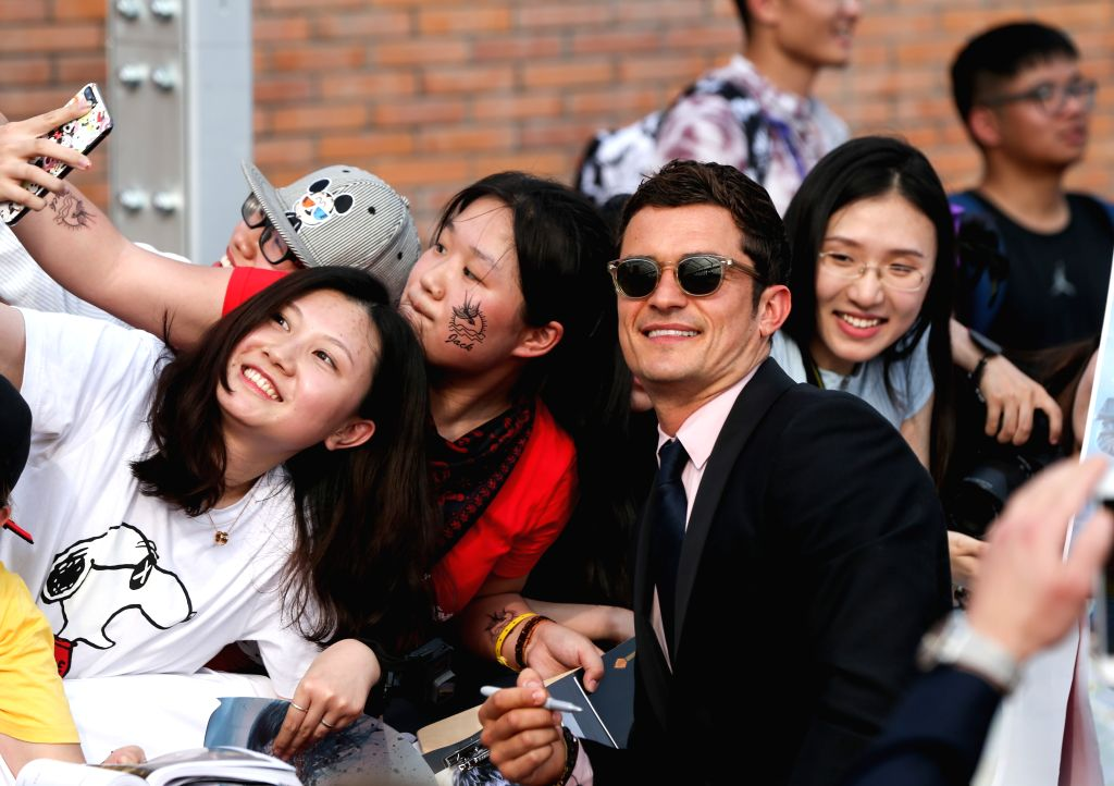 """SHANGHAI, May 11, 2017 - Actor Orlando Bloom attends the global premiere of Hollywood film """"Pirates of the Caribbean: Dead Men Tell No Tales"""", in Shanghai, China, May 11, 2017. (Xinhua/Ding ... - Orlando Bloom"""