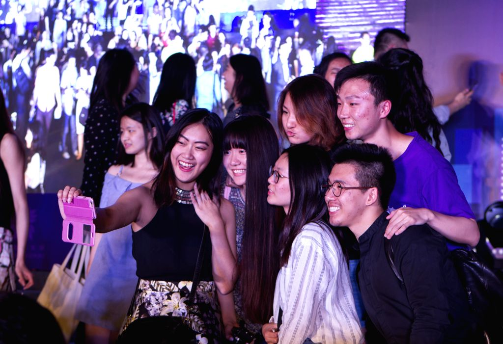 "SHANGHAI, May 29, 2017 - Graduates of China-U.S. university Shanghai New York University (NYU Shanghai) pose for photos after the ""Senior Send Off Performance"" in Shanghai, east China, May ..."