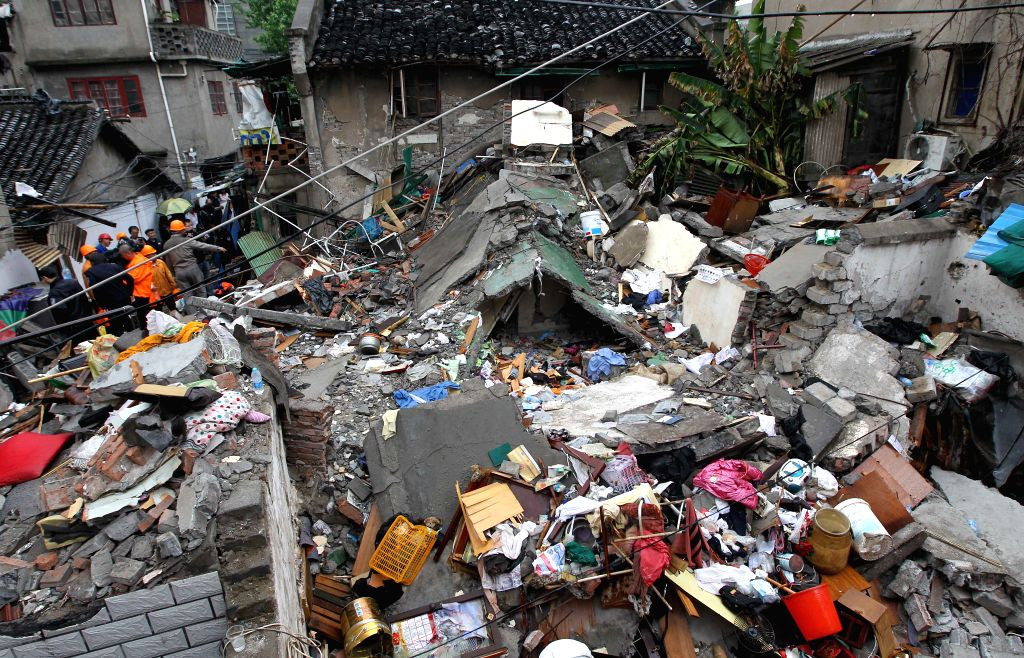 Photo taken on May 4, 2014 shows the accident site of a collapsed building in the Hongkou District of Shanghai, east China. Two people have been confirmed dead and ..