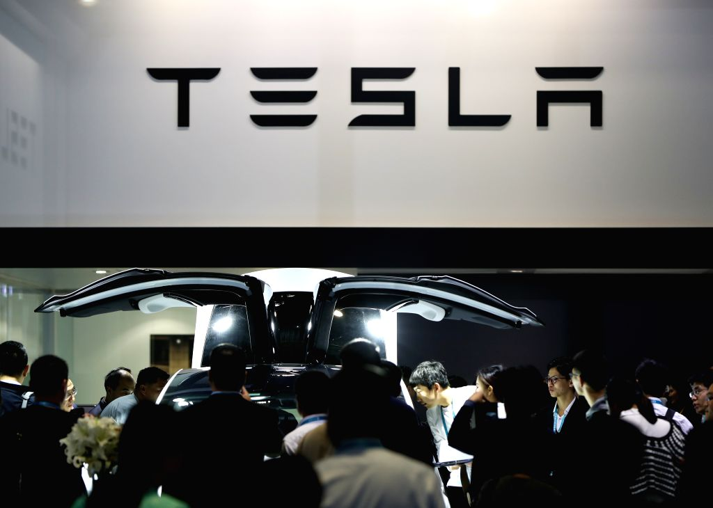 SHANGHAI, Nov. 28, 2019 - Visitors watch a Tesla Model X car during the second China International Import Expo (CIIE) in Shanghai, east China, Nov. 6, 2019. - X