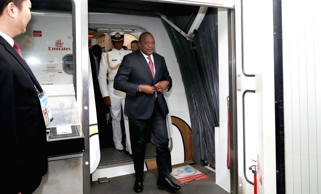SHANGHAI, Nov. 3, 2018 - Kenyan President Uhuru Kenyatta arrives at the Shanghai Pudong International Airport in Shanghai, east China, on Nov. 3, 2018. Kenyatta is here to attend the first China ...