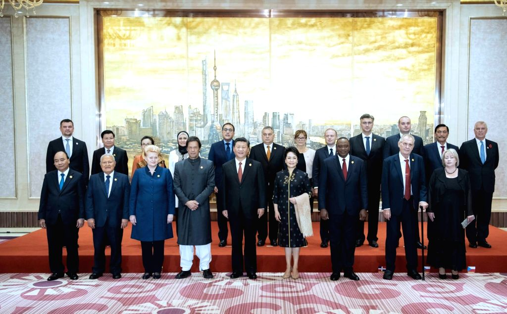 SHANGHAI, Nov. 4, 2018 - Chinese President Xi Jinping and his wife Peng Liyuan take group photos with foreign leaders and their spouses ahead of a banquet in Shanghai, east China, Nov. 4, 2018. Xi ...