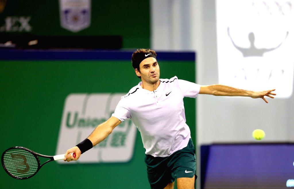 SHANGHAI, Oct. 11, 2017 - Switzerland's Roger Federer hits a return during the men's singles second round match against Argentina's Diego Schwartzman at 2017 ATP Shanghai Rolex Masters in Shanghai, ...