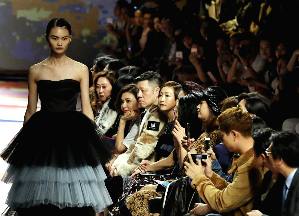 "SHANGHAI, Oct. 12, 2017 - A model presents a creation of ""MOISELLE"" during the Shanghai Fashion Week Spring/Summer 2018 in Shanghai, east China, Oct. 11, 2017."