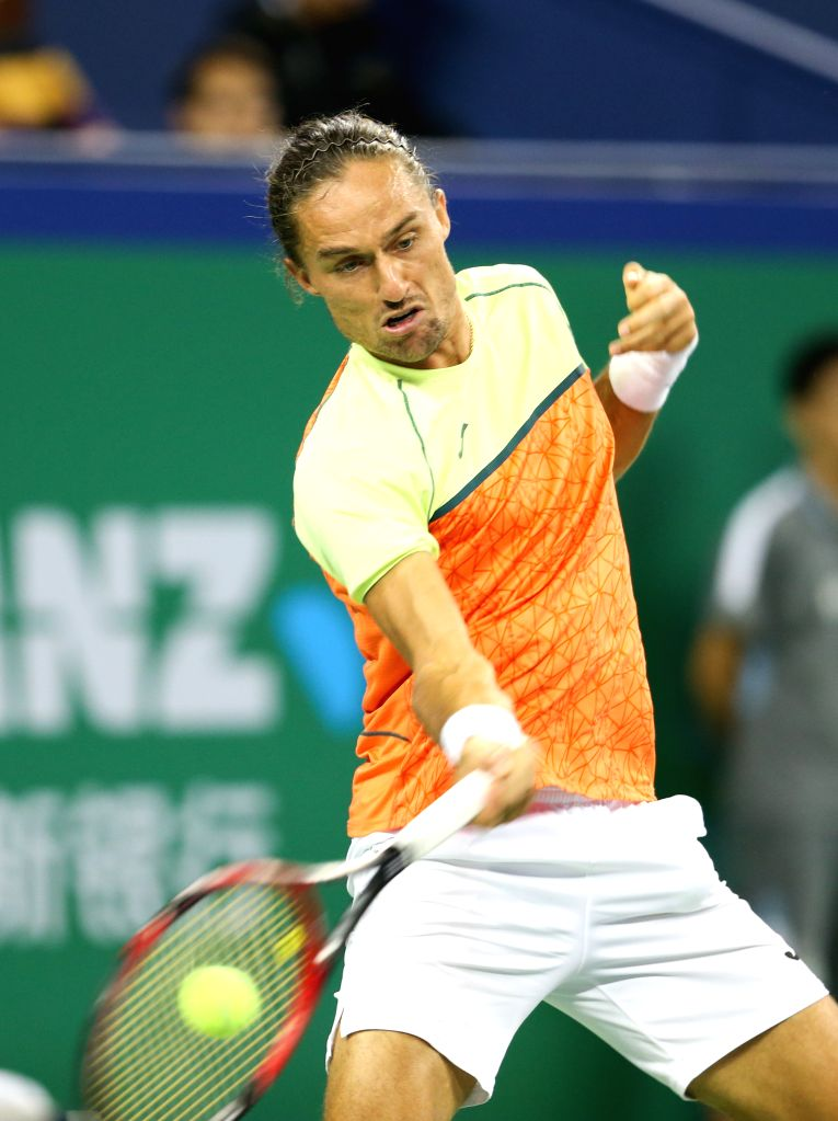 SHANGHAI, Oct. 12, 2017 - Alexandr Dolgopolov of Ukraine competes during the singles third round match against Roger Federer of Switzerland at 2017 ATP Shanghai Masters tennis tournament in Shanghai, ...