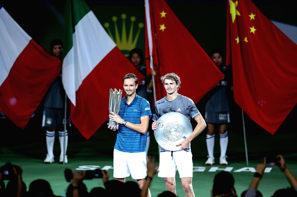 SHANGHAI, Oct. 13, 2019 - Daniil Medvedev(L) of Russia and Alexander Zverev of Germany react during the awarding ceremony after the men's singles final match between Daniil Medvedev of Russia and ...