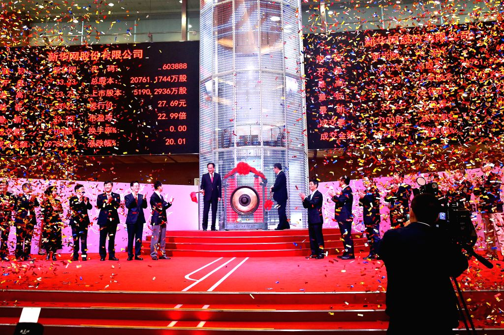 SHANGHAI, Oct. 28, 2016 - A ceremony is held as Xinhuanet Co. Ltd. debuts on the Shanghai Stock Exchange in Shanghai, east China, Oct. 28, 2016. Xinhuanet Co. Ltd. debuted on the Shanghai Stock ...