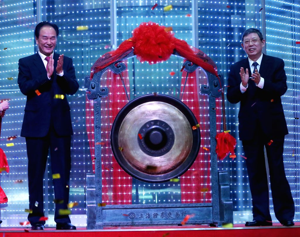 SHANGHAI, Oct. 28, 2016 - Xinhua News Agency President Cai Mingzhao (L) and Mayor of Shanghai Yang Xiong attend the ceremony as Xinhuanet Co. Ltd. debuts on the Shanghai Stock Exchange in Shanghai, ...