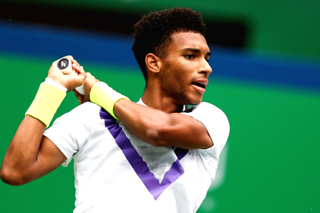 SHANGHAI, Oct. 9, 2019 - Felix Auger-Aliassime of Canada hits a return during the men's singles second round match between Stefanos Tsitsipas of Greece and Felix Auger-Aliassime of Canada at 2019 ATP ...