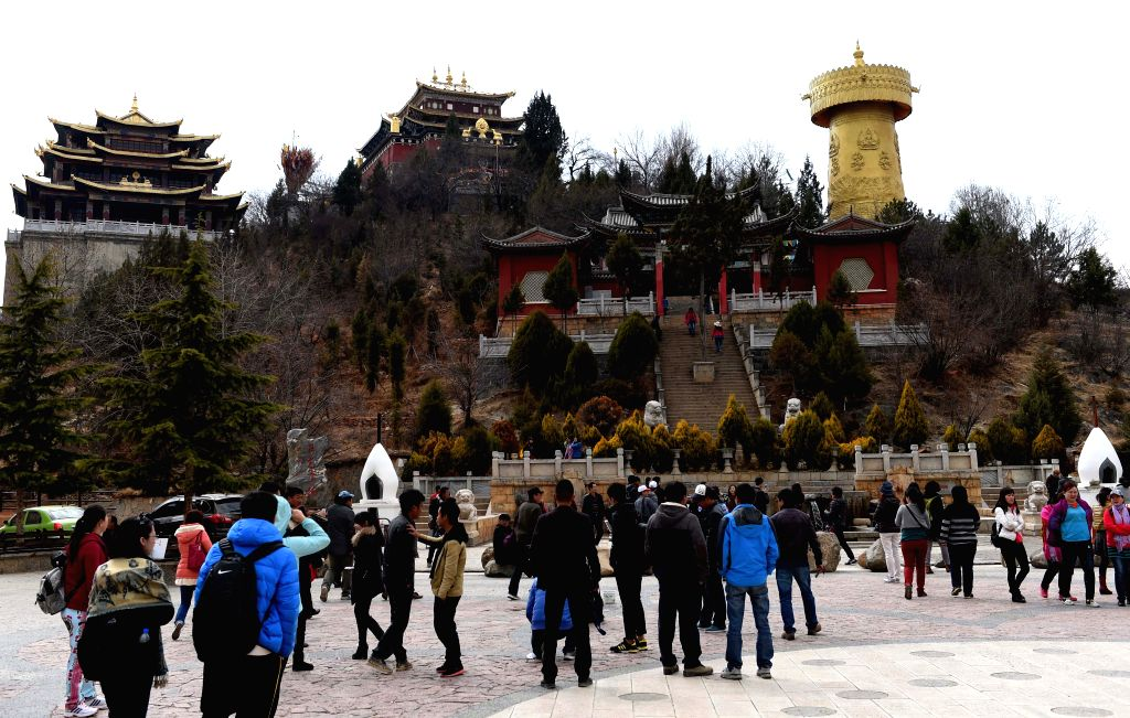 SHANGRI-Tourists visit the ancient town of Dukezong in Shangri-la County, southwest China's Yunnan Province, March 14, 2015. The general restoration project for the ...
