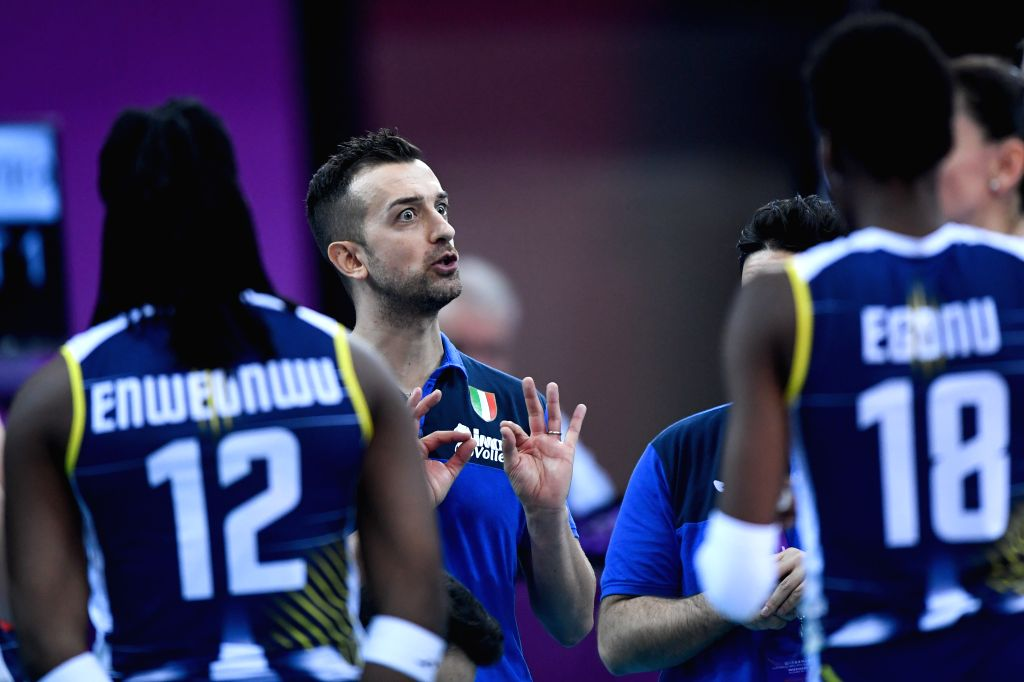 SHAOXING, Dec. 8, 2019 - Daniele Santarell (rear C), head coach of Imoco Volley Conegliano gives instructions during the final match between Imoco Volley Conegliano of Italy and Eczaclbasl Vitra ...